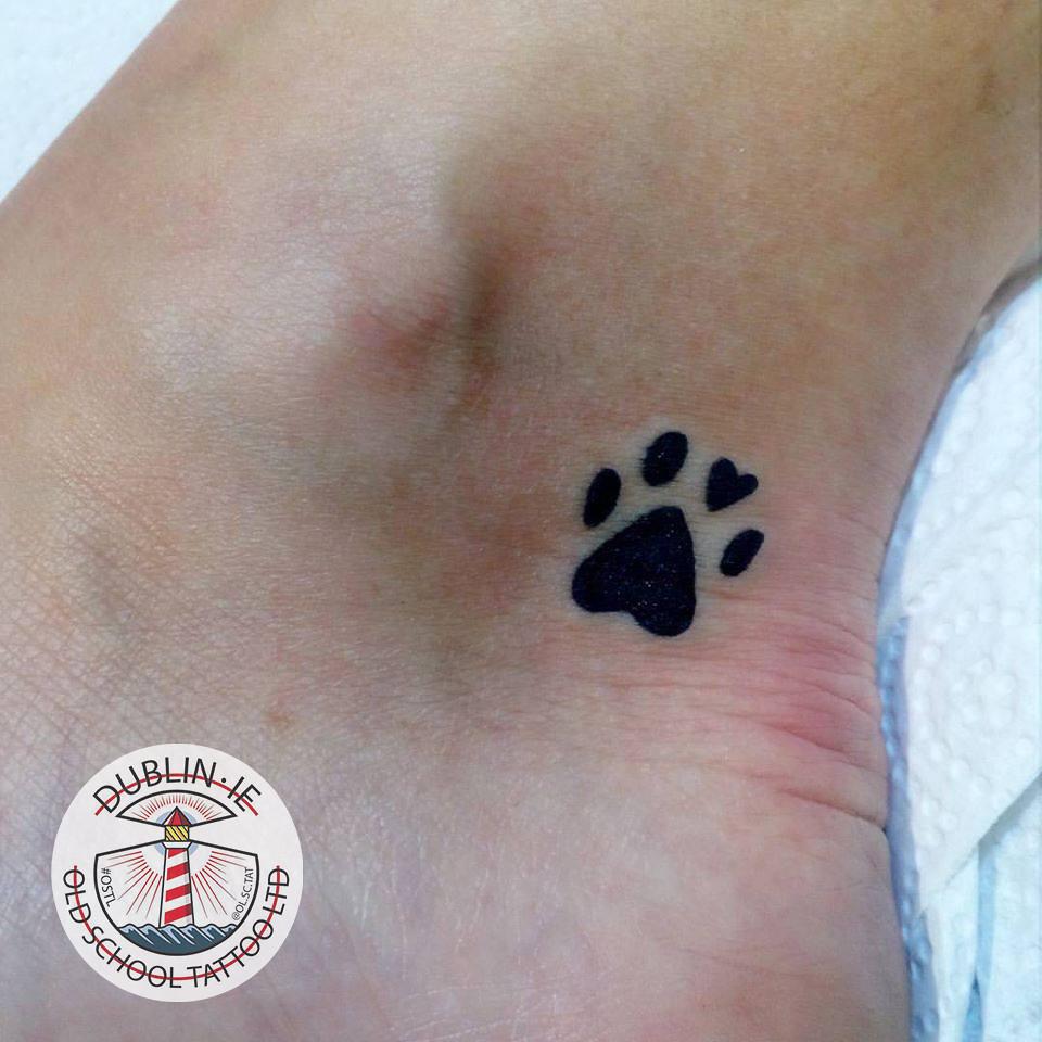 tiny paw print tattoo , paw print tattoo ,small pow print