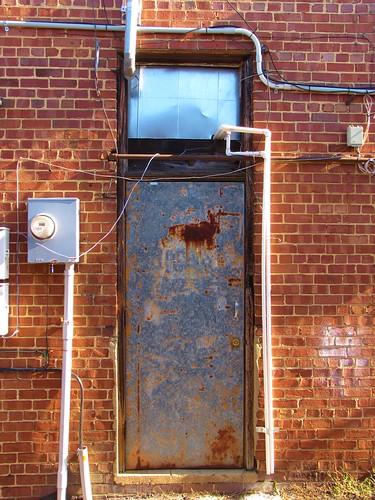 sanford northcarolina leecounty smalltownnorthcarolina smalltown alley backalley forgotten bricks door service wiring skinnydoor skinny rusty rustydoor gerrydincher