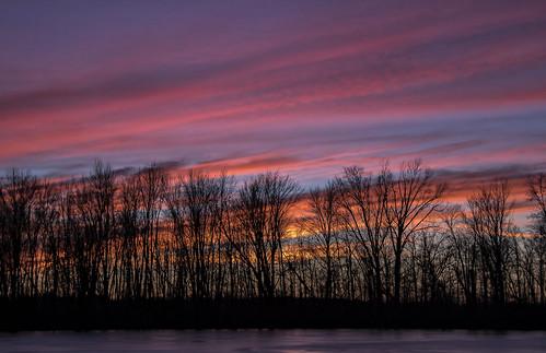 2018 december kevinpovenz westmichigan thebendarea jenison ottawa ottawacounty ottawacountyparks sunset evening dusk trees clouds pink blue red orange yellow canon7dmarkii frozen sky eveningsky