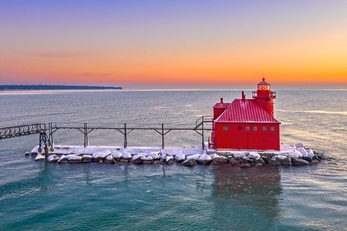 sturgeon bay wisconsin wi lighthouse sunrise sky clouds water lake michigan great lakes pier red orange green morning adventure explore dji mavic 2 pro drone reflection snow ice winter cold art old new colors colorful white light sun sunshine sunlight