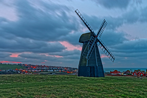 windmill mill sails skirt dawn daybreak morning cloud field grass houses lights sea ocean water longexposure sunrise red green ghe