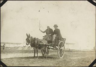 Nursing sister Alice Isaacson (left) of No. 2 Canadian General Hospital riding in a donkey-drawn cart, Le Tréport, France / L'infirmière Alice Isaacson (à gauche), de l'Hôpital général canadien no 2, conduisant une charrette tirée par un âne, Le Trép