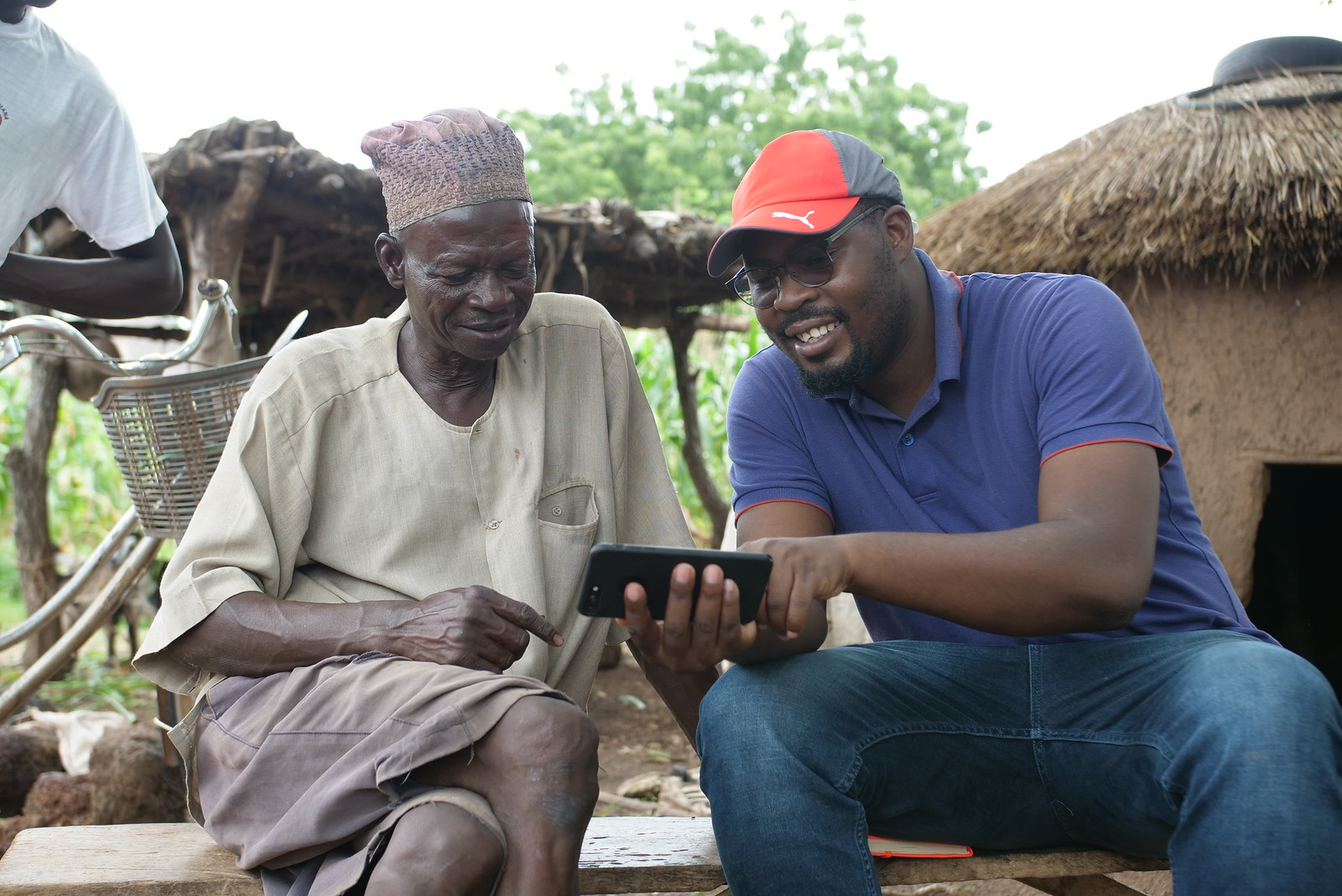 Africa RISING CKS specialist, Jonathan Odhong (right) interacting with a farmer at Cheyohi No. 2 Community  in Northern Ghana. Photo credit: Olaoluwa Olumide Bode/IITA.