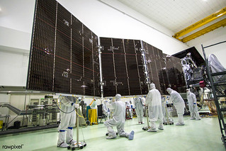 Technicians stow for launch solar array #2 for NASA Juno spacecraft. Original from NASA. Digitally enhanced by rawpixel.