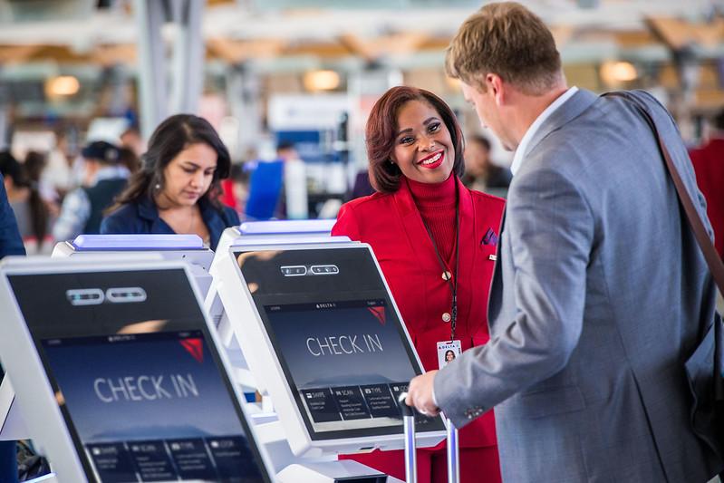 Customer greeted by Delta employee at ATL International Terminal