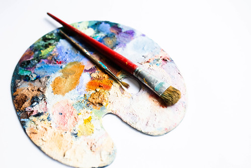 Painter's palette with oil paint and brushes on white background | by wuestenigel