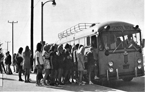 Senior girls getting on a Crown School Bus that will take them to see the play Room Service in 1970 St. Bernard High School in Playa del Rey, CA