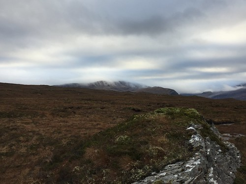Wisps of cloud settling on Creag Rainich   by malky_c