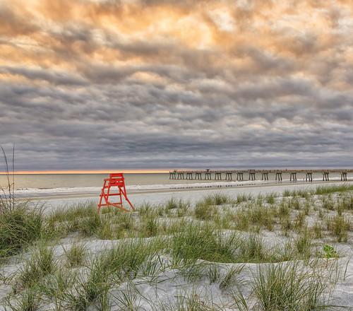 florida jacksonvillebeach sunrise clouds beach ocean seaoats fishingpier lowtide