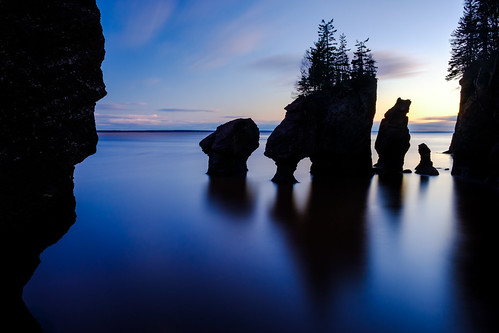 hopewellrocks newbrunswick nb canada cans2s 2018 water tide tidal rocks force erosion evening light silhouette shadow reflection smooth clouds trees fujixe3 color colour longexposure le backlight backlit landscape seascape sandstone fundy bayoffundy