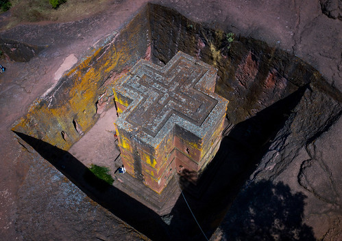 aerialview africa amhararegion ancient architecture builtstructure carving christianity church colourimage colourpicture cross day drone ethiopia ethiopia18dr0195 famousplace fullframe giyorgis history horizontal hornofafrica internationallandmark lalibela medieval monolithic monument nopeople orthodox orthodoxchurch outdoors photography placeofworship religion rock saintgeorge scenics spirituality stgeorge stgeorgeschurch traveldestinations unescoworldheritagesite et