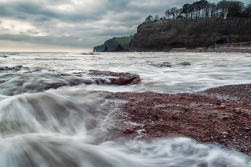 dawlish coryton cove beach longexposure lowangle perspective pointofview pov redsand coastline coastal devon rugged seascape landscape overcast cloudy canon eos50d tamron 1750mm water sea ocean atlantic wave incoming movement cliffs seastacks