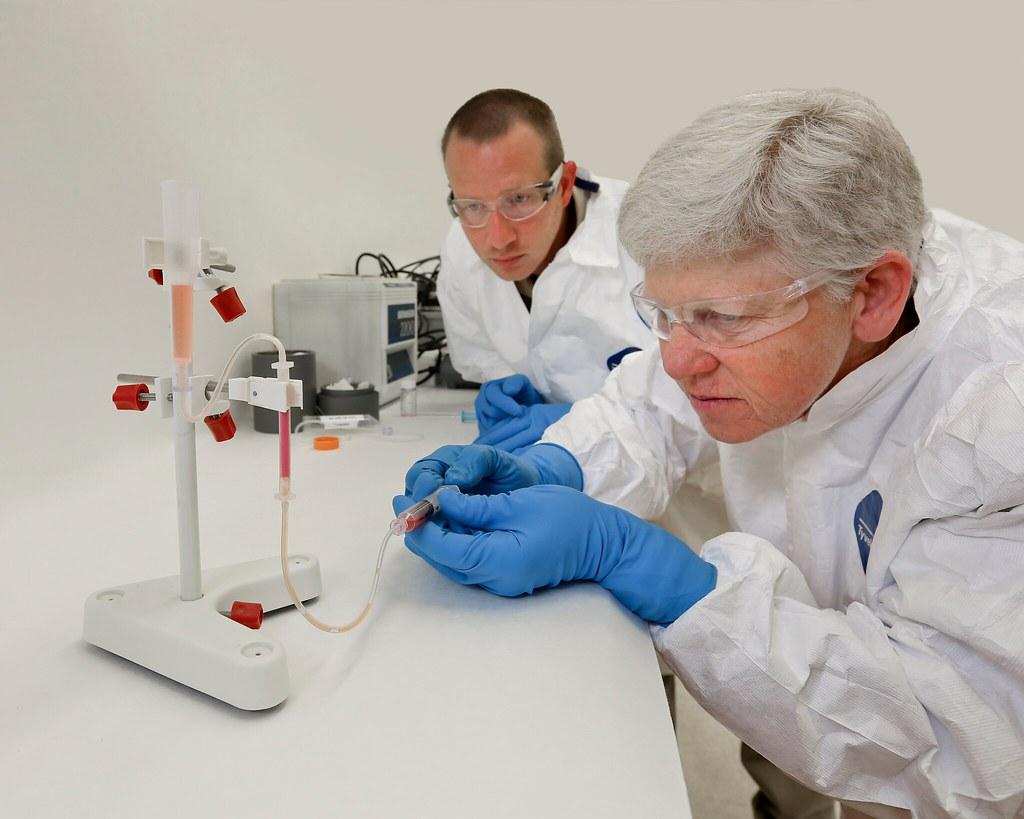 Medical professionals using radioisotope equipment