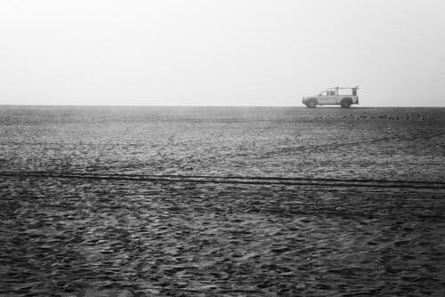 d800e raw bw sealbeach california car lifeguard seagulls beach sand tracks fog mist pacificocean usa silence simplicity aoi peaceaward world100f