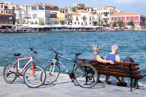 chania holiday crete greece 2018 two cyclists harbour sea