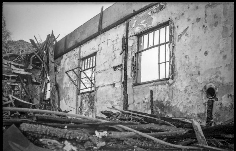 burned out building IV, charred and fallen beams, windows, Asheville, NC, Minolta Freedom Dual 60, Kodak TMAX 400, Ilford Ilfosol 3 developer, 3.13.19