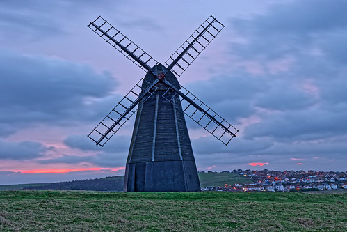 windmill mill building architecture structure historic sails skirt sunrise dawn daybreak morning cloud sky grass village lights houses rottingdean sussex