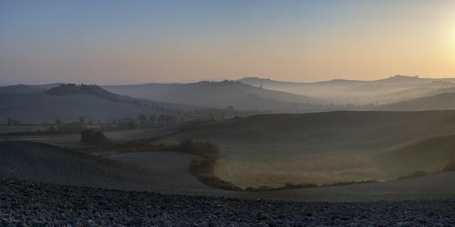 *During the sunrise in the fields of Crete Senesi*