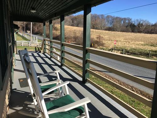 jerusalemmillvillage harfordco maryland gunpowderfallssp mdstateparks countrystore porch chairs fences railings fields shadows hbm iphone