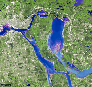 Marie is the name of two cities on Saint Mary's River, separating Canada and the State of Michigan in the United States. Original from NASA. Digitally enhanced by rawpixel.