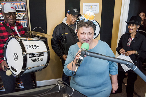Beth Arroyo Utterback on air with Treme Brass Band at WWOZ's 38th birthday celebration - 12.4.18. Photo by Ryan Hodgson-Rigsbee rhrphoto.com.