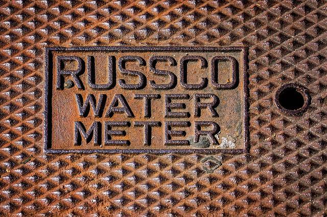 Russco water meter lid on Dauphin Street in downtown Mobile Alabama