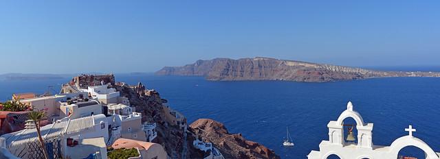 Oia village, Santorini. Beyond, the island of Thirassia beckons invitingly