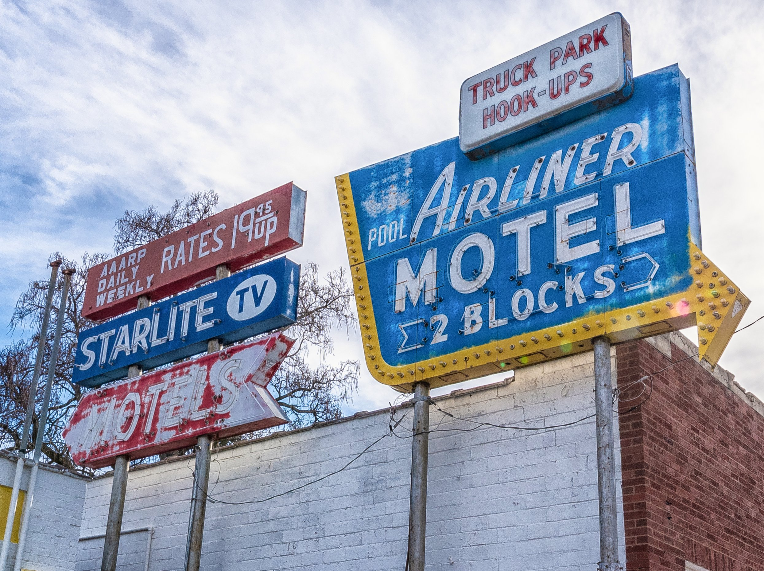Starlite Motel and Airliner Motel signs - West Pacific Avenue and 9th Street, Salina, Kansas U.S.A. - December 24, 2018