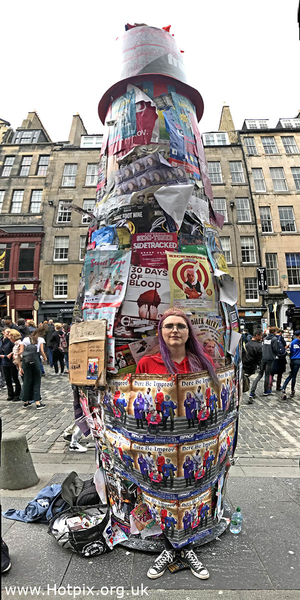 How best to attract attention when handing out flyers,on the Edinburgh Royal Mile,for fringe show 'Here Be Improv!' ?  Well you could tape yourself up to one of the poster cylinders?  The funny folks of Durham Improvised Comedy Society,Shellshock! describe it as follows:  Join the (dis)Order of Improvised Comedy in their quest to wondrous realms of hilarity. Interactive and dynamic, this family-friendly show brings a new medieval fantasy to life on a (k)nightly basis! The goodly knights,in the taking of this photograph.  If you are on Twitter,do add a follow there and I will follow back in return <a href=https://mobile.twitter.com/HotpixUK rel=nofollow>mobile.twitter.com/HotpixUK</a>   Find the cast on twitter at @ShellShockImpro   All images (c) Tony Smith - @HotpixUK - No images to be used w,GoTonySmith,HotpixUK,Hotpix,Tony Smith,HousingITguy,365,Project365,2nd 365,HotpixUK365,Tone Smith,Edinburgh Festival,August,2018
