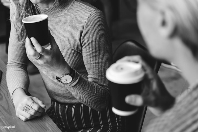 Friends enjoying a hot coffee together