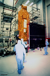 NASA's Far Ultraviolet Spectroscopic Explorer satellite at Hangar AE, Cape Canaveral Air Station. Original from NASA. Digitally enhanced by rawpixel.