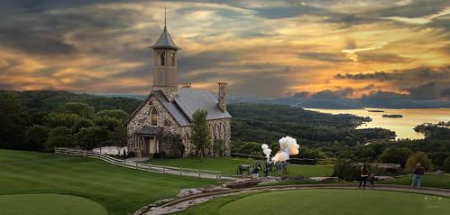 topoftherock ozarkspreserve weddingchapel church steeple greens golfcourse cannon civilwar reenactment fire salute lake water lakeoftheozarks hollister branson missouri sunset beautiful sky landscape scene scenery vista view mountains islands onlookers tourists people soldiers explosion firing clouds cloudy hillside mountainside valley rock stone stonework smoke woodlands trees stevefrazierphotography shore shoreline dusk evening composite photomanipulation digitalmanipulation