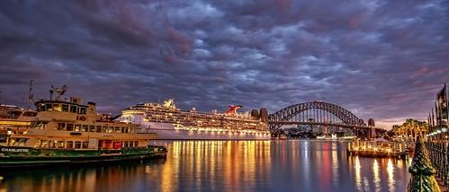 sydney harbour bridge ferry cruise ship night sky clouds australia