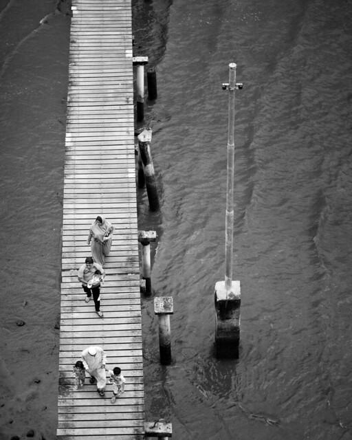 Family in water village, Brunei
