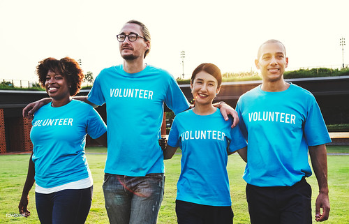 Group of happy and diverse volunteers   by Rawpixel Ltd