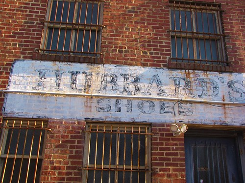 sanford northcarolina leecounty smalltownnorthcarolina smalltown bricks brightcolors brickcity downtownsanford ghostsign paintedadvertisement vintage hubbardsshoes hubbards windows barsonwindows secure gerrydincher