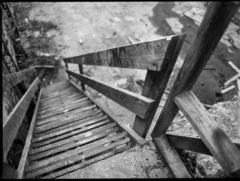 looking down, metal staircase, wooden railings,River District, Ashevile, North Carolina, Mamiya 645 Pro, mamiya sekor 45mm f-2.8, Bergger Pancro 400, Ilford Ilfosol 3 developer, 1.5.19