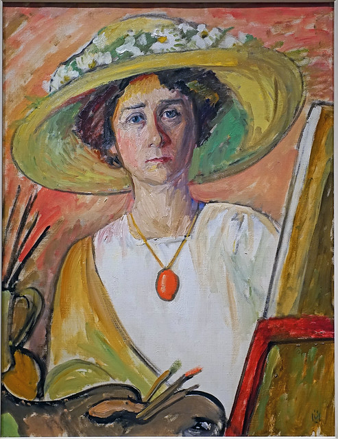 Gabriele Münter - Self-portrait in front of an easel [1908-09]  -