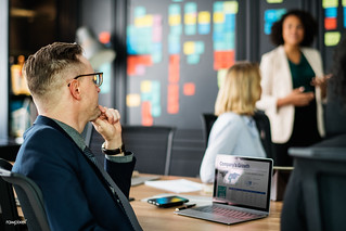 Business people in a meeting | by Rawpixel Ltd
