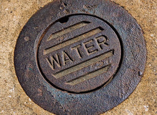Water meter manhole cover on Dauphin Street in downtown Mobile Alabama