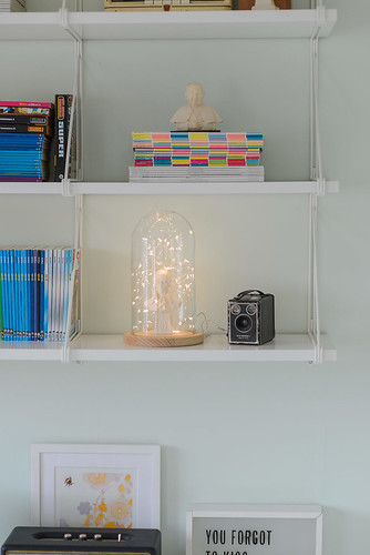 Shelfie with fairy lights in a glass dome | by jutta / kootut murut