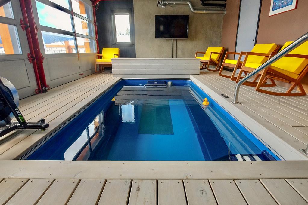 Endless Pools swimming machine behind garage doors | Flickr