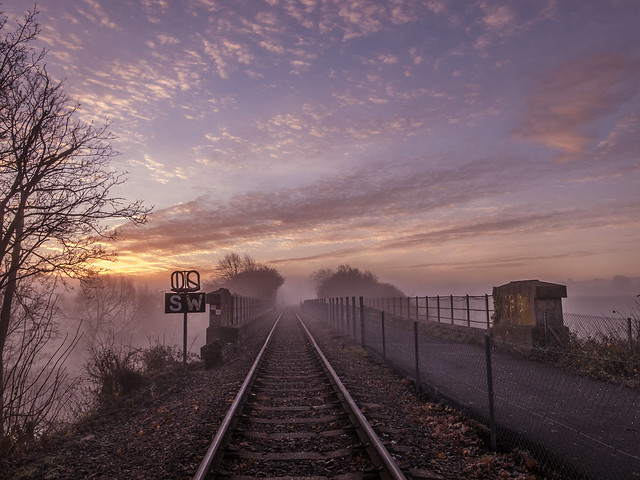 sunrise frosty pastel colours train track perspective