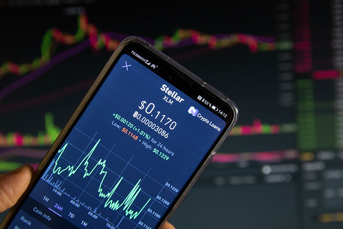 A smartphone displays the Stellar market value on the stock exchange | by wuestenigel