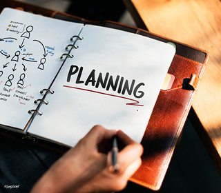 Woman writing and planning business strategy | by Rawpixel Ltd