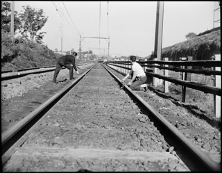Safety first photos. Youths placing obstacles on line in path of approaching train. | by NSW State Archives and Records