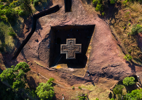 aerialview africa amhararegion ancient architecture builtstructure carving christianity church colourimage colourpicture cross day drone ethiopia ethiopia18dr0232 famousplace giyorgis history horizontal hornofafrica incidentalpeople internationallandmark lalibela medieval monolithic monument orthodox orthodoxchurch outdoors photography placeofworship religion rock saintgeorge scenics spirituality stgeorge stgeorgeschurch traveldestinations unescoworldheritagesite et