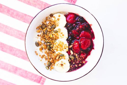 Breakfast oatmeal bowl with granola, bananas and jam on top | by wuestenigel