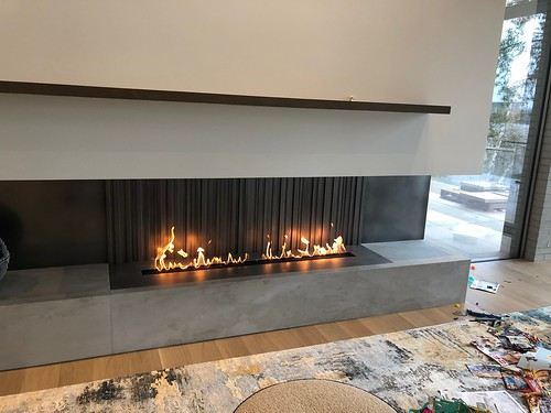 Custom 3 sided gas fireplace.   by Thompson's Hearth & Home
