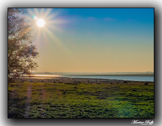 Rising sun on the Der lake